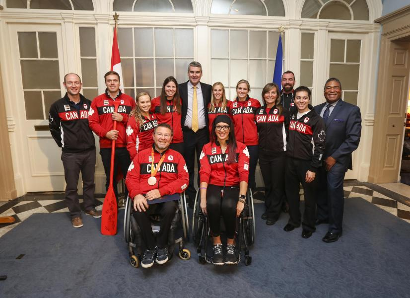 Premier Stephen McNeil (centre) and Communities, Culture and Heritage  Minister Tony Ince (right) with Olympians and Paralympians at Province House.