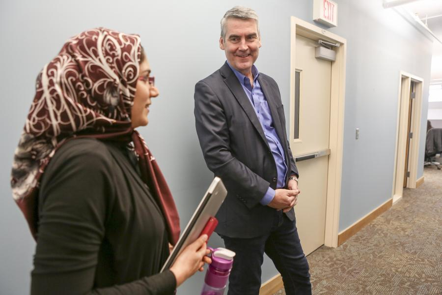 Premier Stephen McNeil with Somayeh Kafaie, an employee at Colibri.