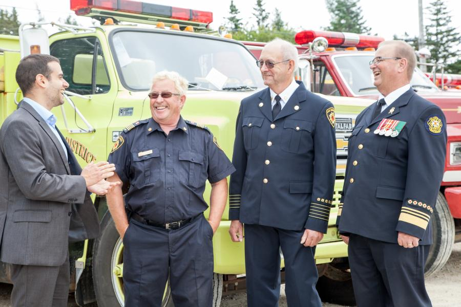 Municipal Affairs Minister Zach Churchill laugh with Fire Marshal Harold Pothier and Fire Chiefs Scott Killam and Earle Raynard.