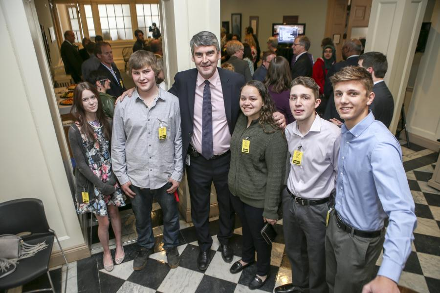 Premier Stephen McNeil with young public sector workers during Make it Here announcement at Province House.