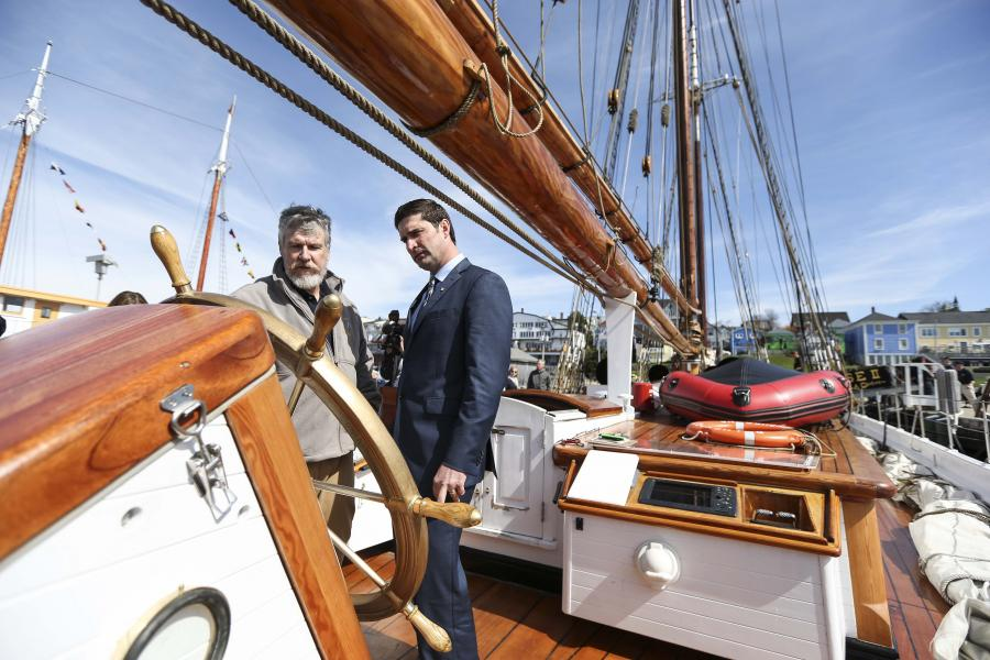 Transportation and Infrastructure Renewal Minister Geoff MacLellan chats with Bluenose II Captain Phil Watson in Lunenburg.