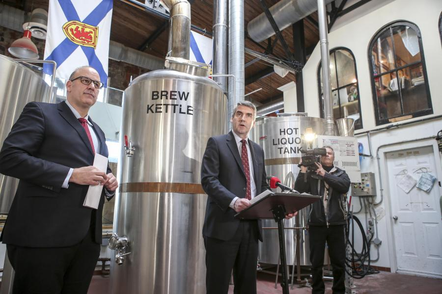 (From left) Minister of the Public Service Commission Labi Kousoulis and Premier Stephen McNeil at the Garrison Brewing Co. in Halifax.