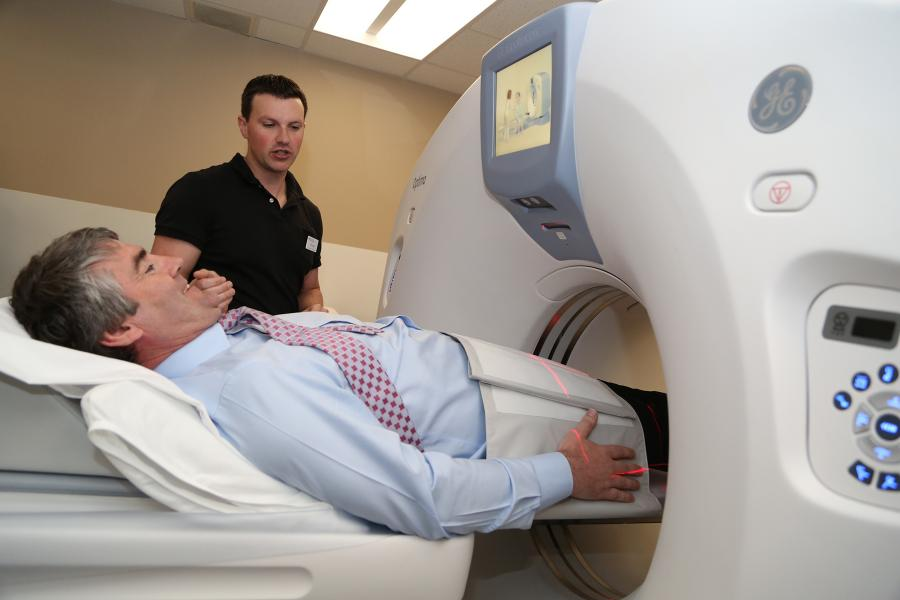 Premier Stephen McNeil gets a close view of the new CT Scanner.