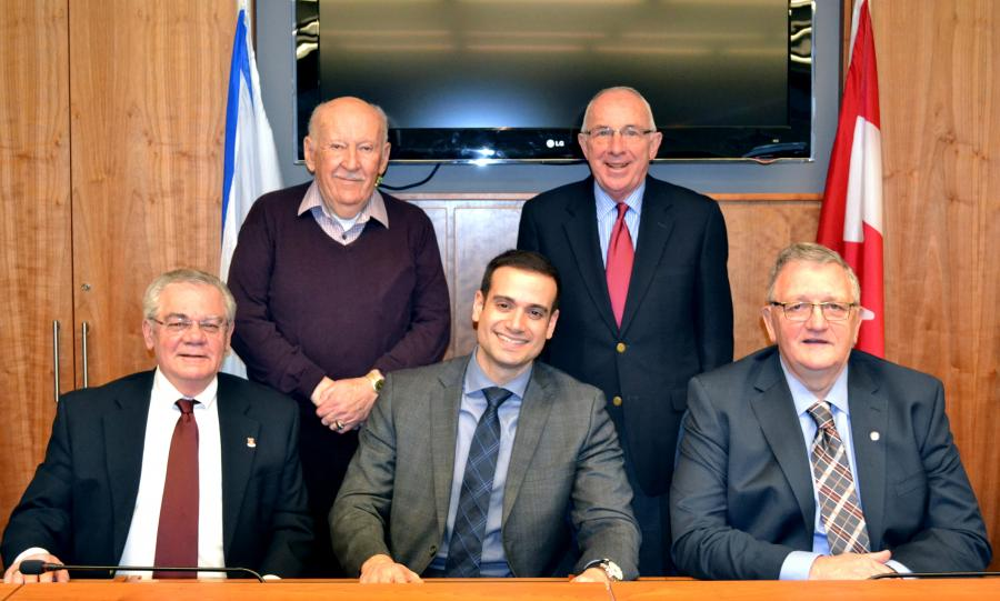 Municipal Affairs Minister Zach Churchill (centre) joined (left to right) Pictou Mayor Joe Hawes, Stellarton Mayor Joe Gennoe, New Glasgow Mayor Barrie MacMillan and Pictou County Warden Ronald Baillie to sign an agreement supporting amalgamation of these municipalities.