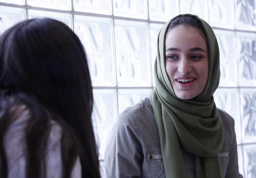 A young immigrant smiles in a school hallway. Last year, 2,661 newcomers settled in the province. This included 717 people coming through the Nova Scotia Nominee Program, the highest number yet for the program.