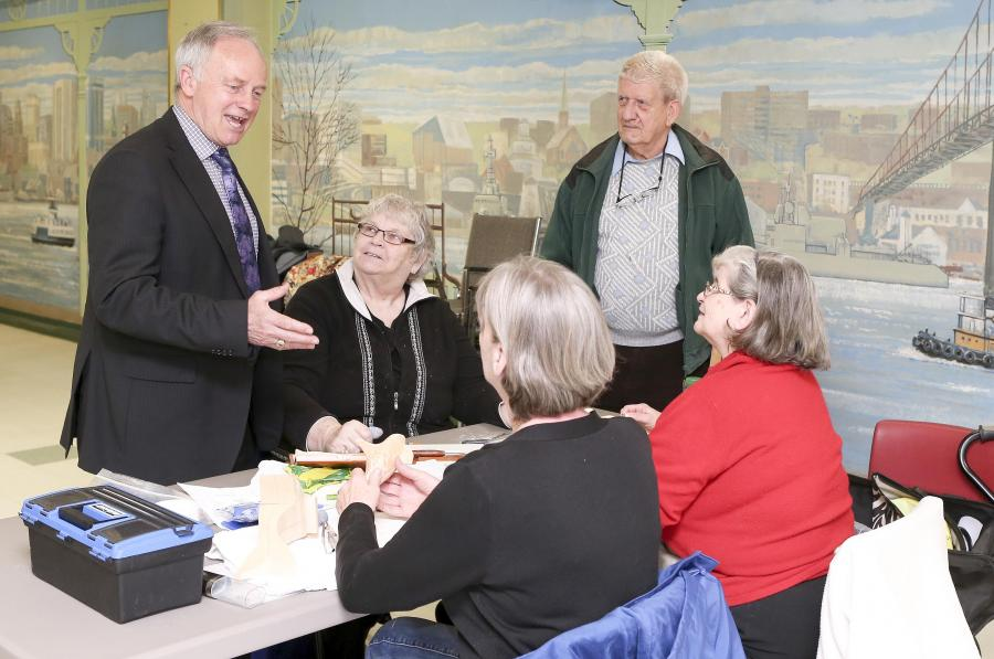 Seniors Minister Leo Glavine chats seniors in Dartmouth.