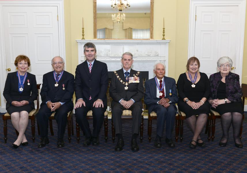The 2015 Order of Nova Scotia recipients sit for the official photo with Premier Stephen McNeil and Lt.-Gov J.J. Grant