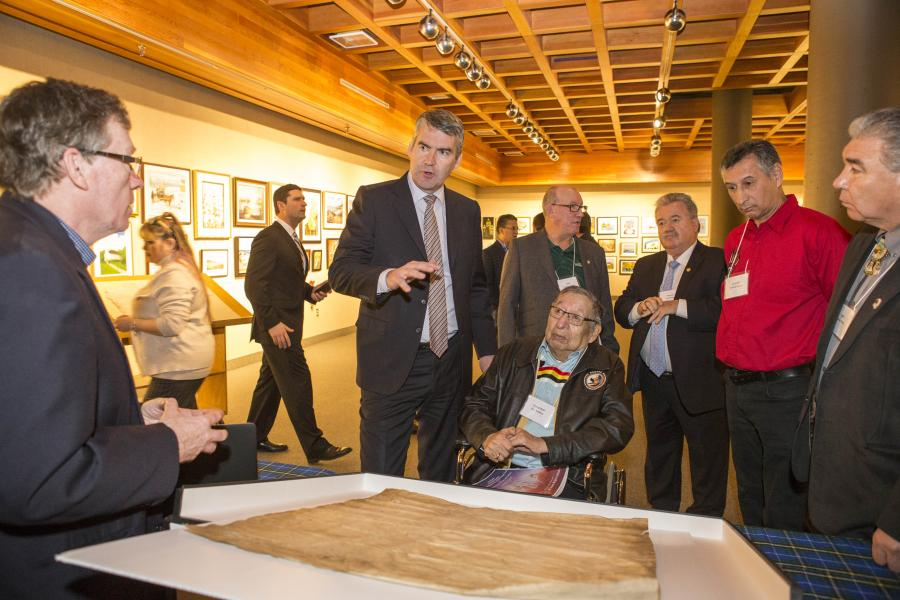 From left: John MacLeod, Nova Scotia Archives, explains the 1725 treaty document to Premier Stephen McNeil, Chief Terrance Paul, Grand Chief Ben Sylliboy, Natural Resources Minister Lloyd Hines, Chief Andrew Denny and Chief Sydney Peters.