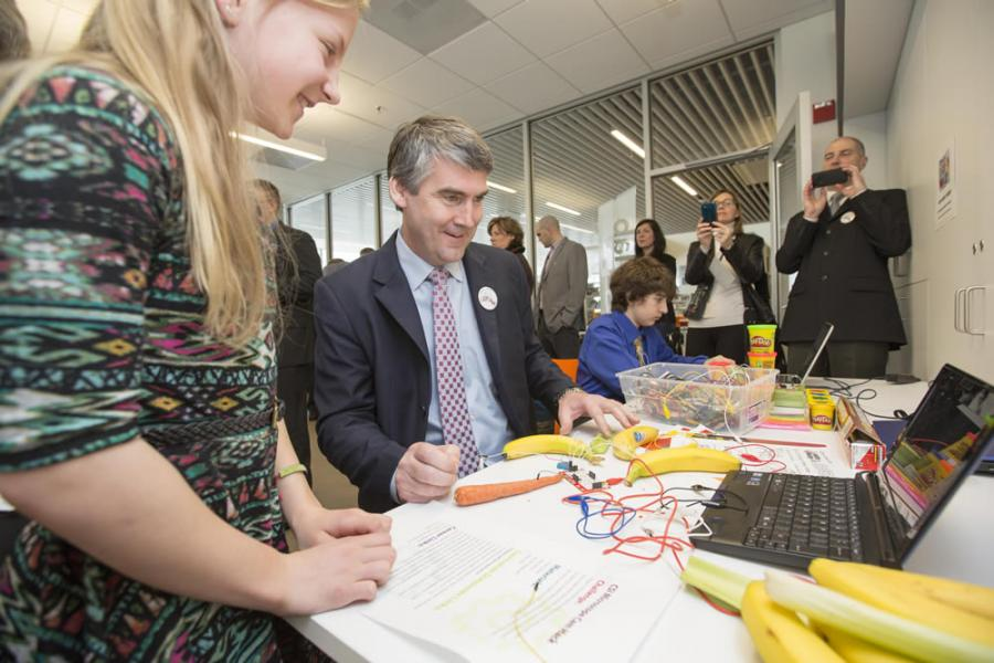 Gatesbrook Junior High School Grade 7 student Keira Cassidy smiles as she explains to Premier Stephen McNeil how to use fruits and vegetables to play music.