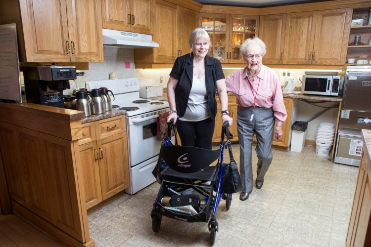 Two seniors in a kitchen