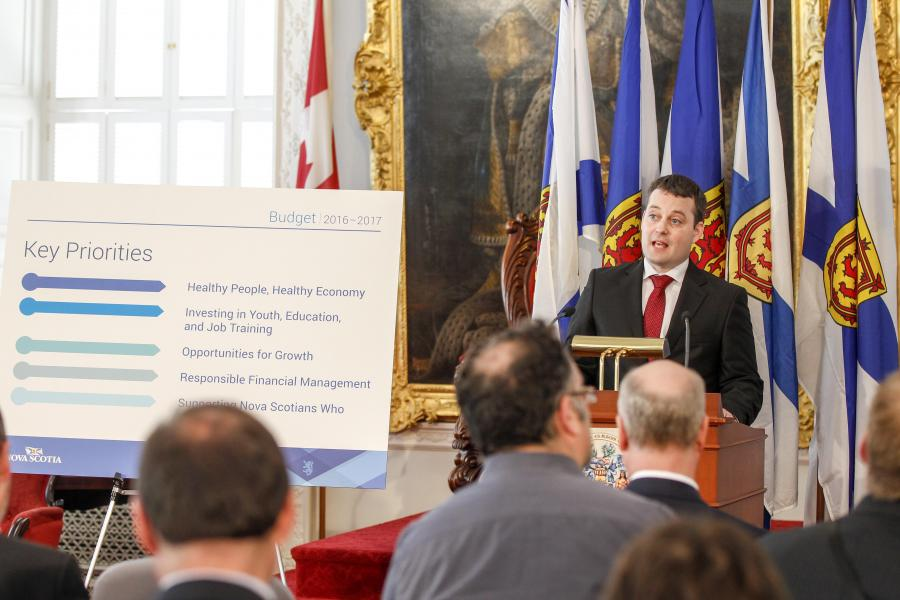 Finance and Treasury Board Minister Randy Delorey addresses the media in the Red Chamber of Province House in Halifax.