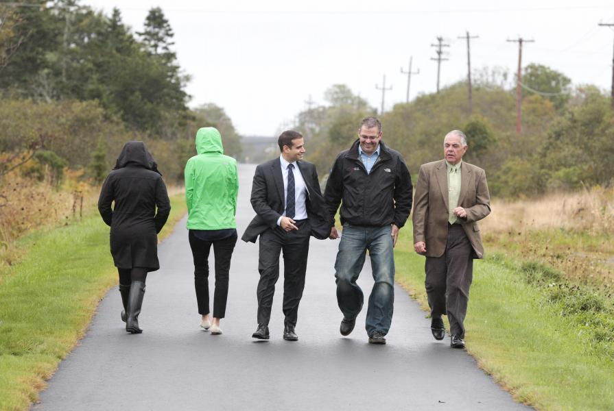 Municipal Affairs Minister Zach Churchill, Yarmouth recreation director Frank Grant and councillor Phil Mooney walk on the Maud Lewis Trail.