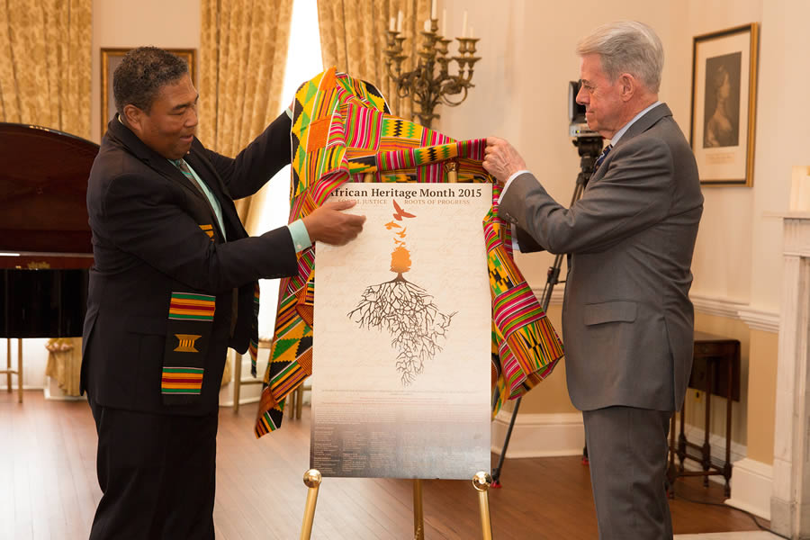 Lt.-Gov. J.J. Grant (right) and Communities, Culture and Heritage Minister Tony Ince (left) unveil the poster for NS African Heritage Month 2015.