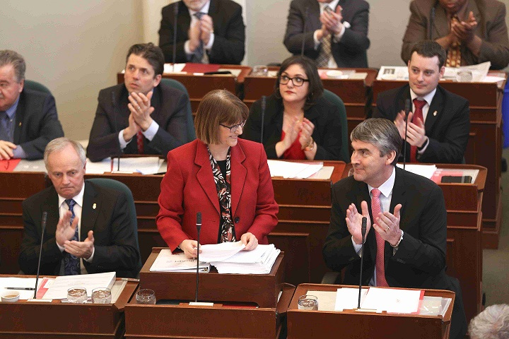 Finance and Treasury Board Minister Diana Whalen smiles as Premier Stephen McNeil applauds during the Budget 2015-16 address.