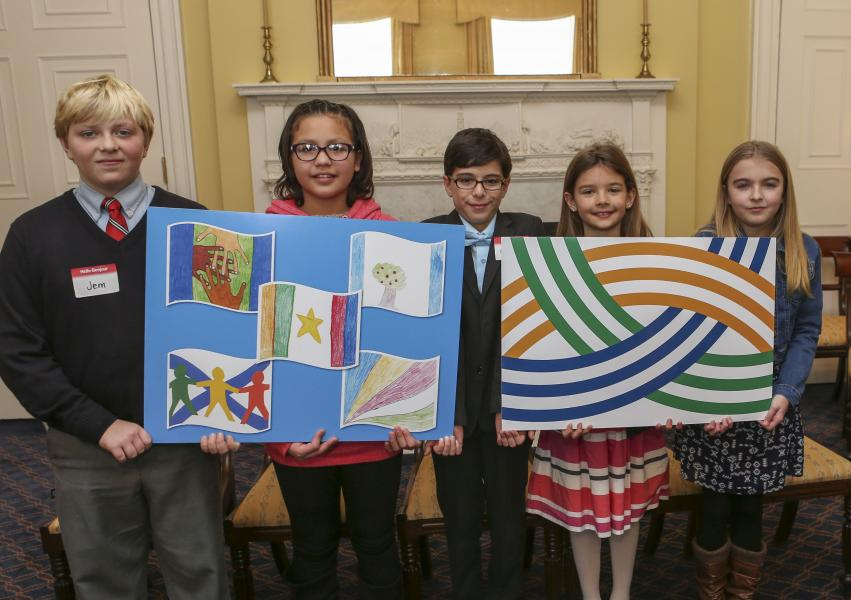 Five students show off their original illustrations that inspired the province's new Heritage Day flag design and the finished product.  They are (from left to right) Jem Logan, Upper Tantallon; Lyric Gould, Eskasoni, Cape Breton Regional Municipality;  Gage Michael Richard, Halifax; Keira Mercer, Beechville; and Sophie Anne Imlay, Boylston, Guysborough Co.