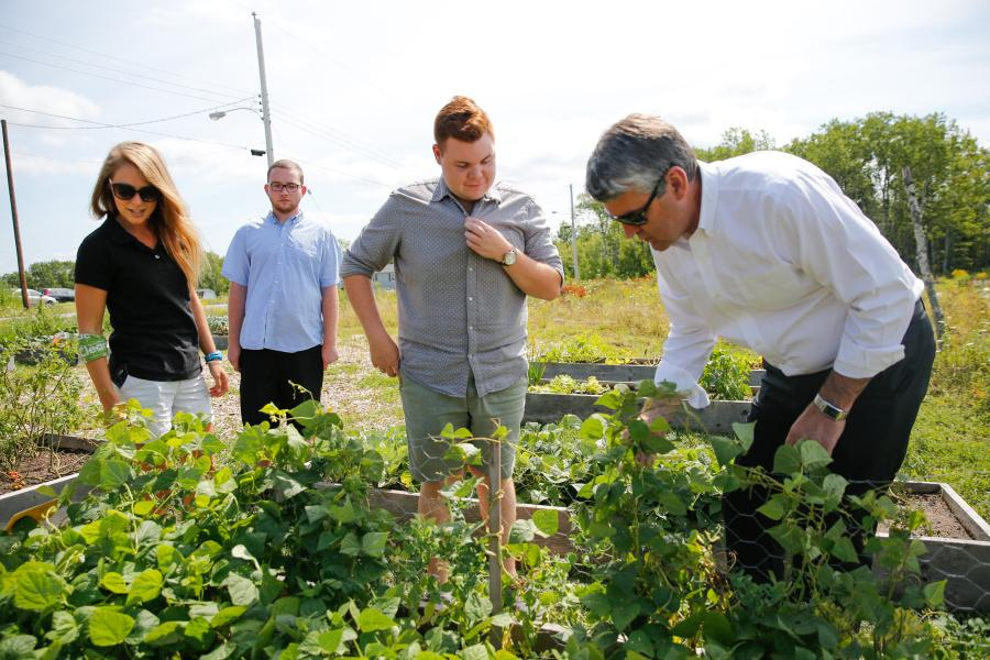 Morgan Brook of Clean Foundation, Clay Gaudet, Nova Scotia Youth Conservation Corp student, Jerid Watton, aboriginal youth leader and Premier McNeil tour the garden