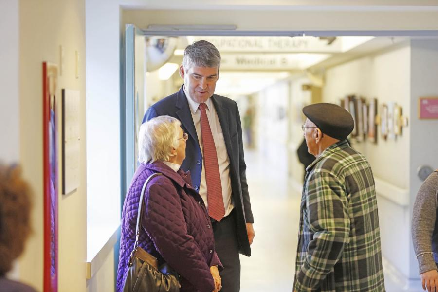 Premier Stephen McNeil with patient Mac Benjamin of New Minas and his wife Muriel.
