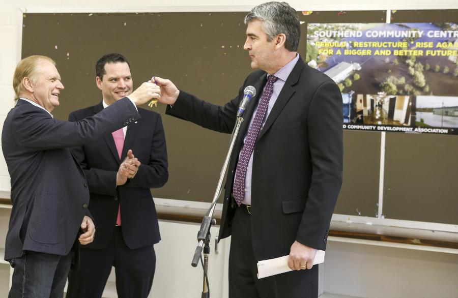 Premier Stephen McNeil hands over the keys to Rick Fraser, director of the Southend Community Centre.