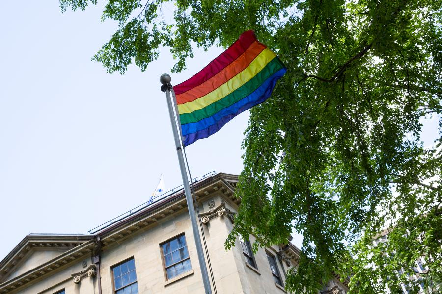 The Pride flag flies outside Province House.