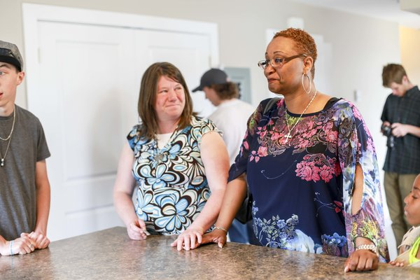 Mothers, Crystal Malay and Rhonda Johnson react after receiving the keys to their new homes.
