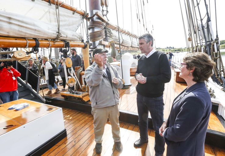 Capt. Phil Watson chats with Premier Stephen McNeil, and Lunenburg mayor Rachel Bailey onboard the Bluenose II.